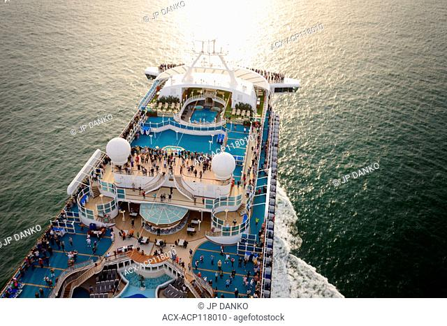 Overhead view of a cruise ship as it heads out to open water