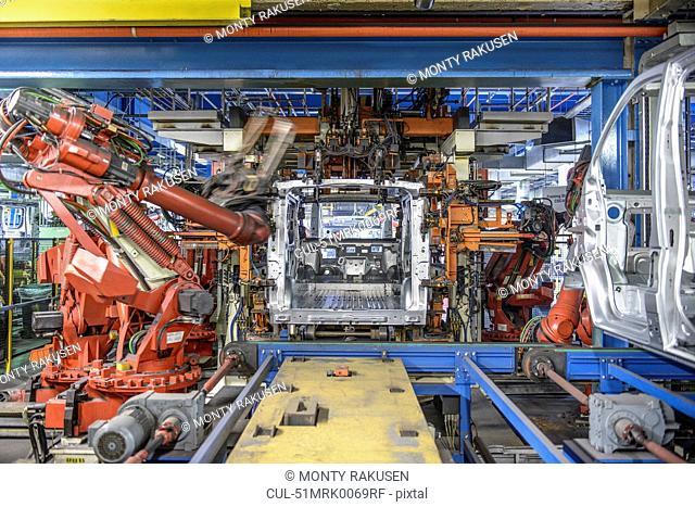 Robots welding van body in car factory
