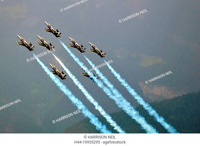 SION, SWITZERLAND, Breitling jet team in close formation trailing smoke at the Breitling Air show. September 17, 2011 in Sion, Switzerland