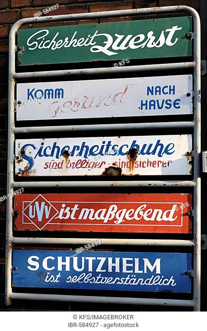 Old enamel signs with notes concerning safety measurements, entrance of the power station Hermann Wenzel, Duisburg-Ruhrort, NRW, Germany