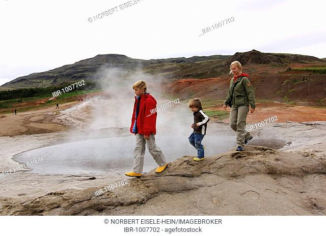 Woman and two children, hot spring, geyser, Iceland, Europe