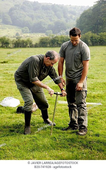Men using Russian corer to sample peat, climate change research, Neiker-Tecnalia, Unit of Environment, Belate, Navarra, Spain