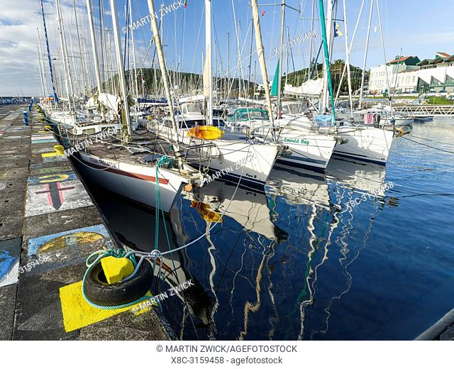 The marina with the famous drawings and paintings of sailors, a landmark of Horta. Horta, the main town on Faial. Faial Island