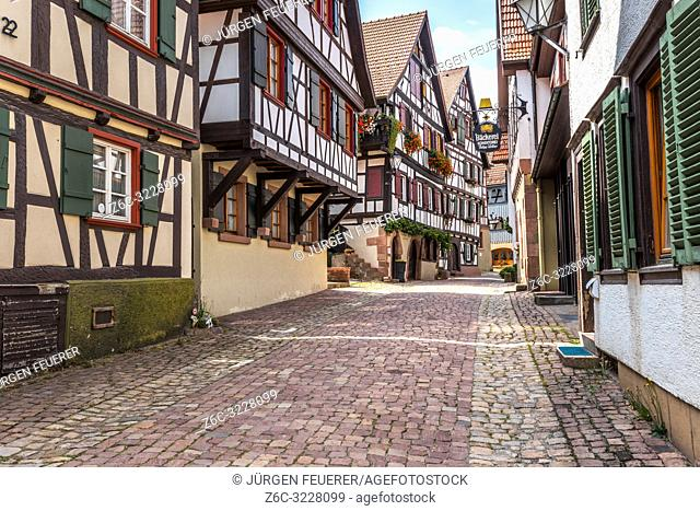 old town Schiltach, Black Forest, Germany, cobblestone lane lined by half-timbered houses