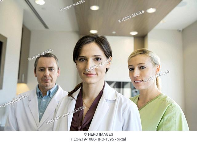 Portrait of confident dentists and assistant