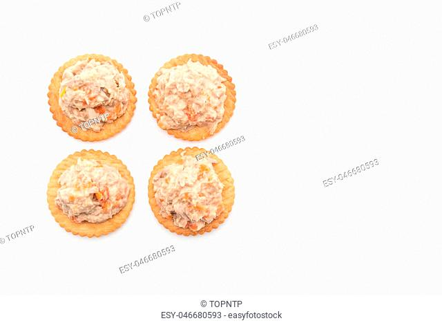 tuna salad with cracker on white background