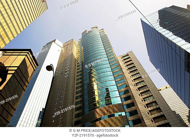 Looking up at office buildings in Central district, Hong Kong