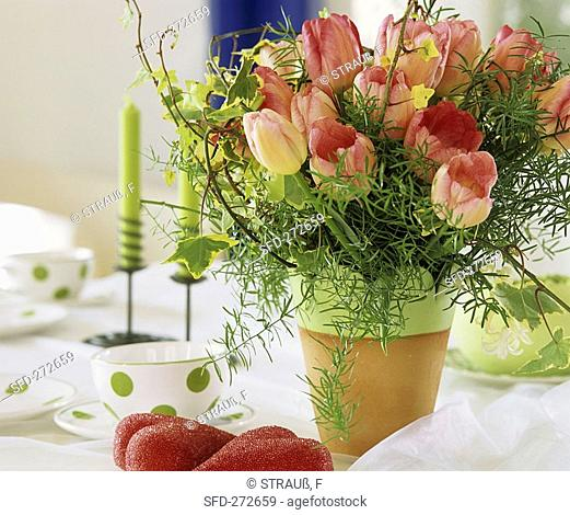 Arrangement of tulips, ivy and ornamental asparagus