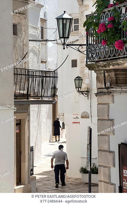 In the narrow side streets of Locorotondo, in the Itria Valley, Puglia, Italy