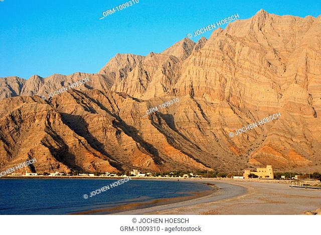 Coast on Musandam with Bukha fort, Oman