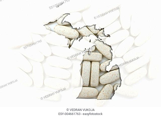 Outline map of michigan with transparent pills in the background