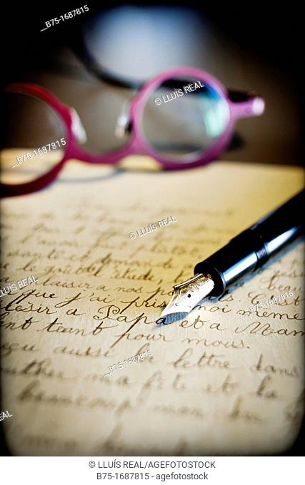 old handwritten letter postmarked, pen stylographic and glasses