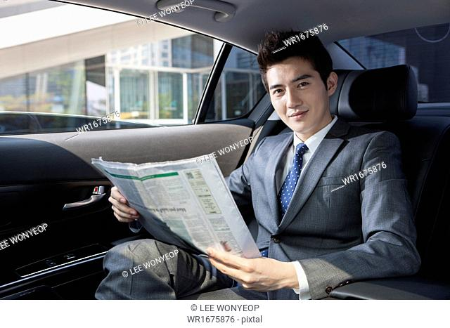 a business man sitting in his car