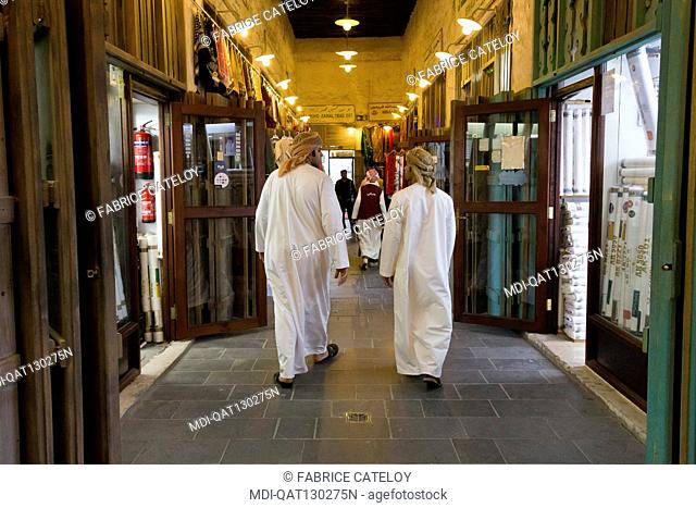 Qatar - Doha - Souk Waqif - Qatari walking in the souk