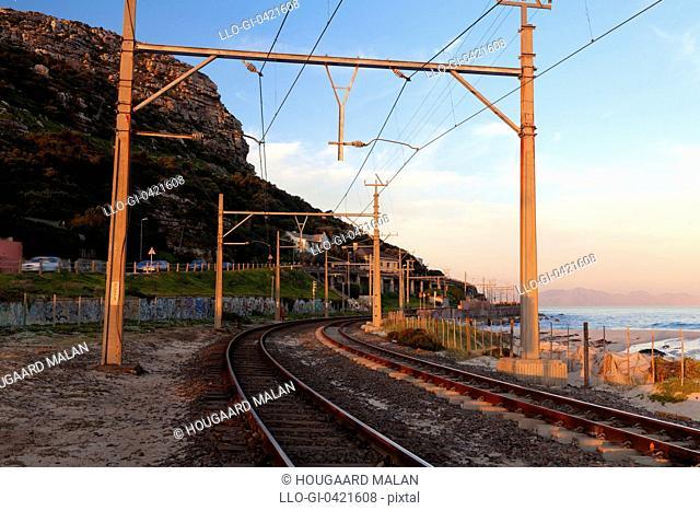 Wide angle view of the cape peninsula railway near Clovelly beach. Cape Peninsula, Western Cape, South Africa