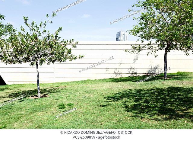 Concrete wall and garden. Valencia, Spain