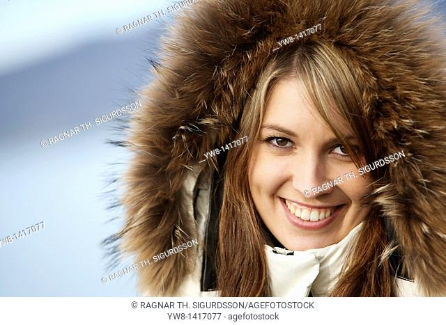 Young woman wearing hood