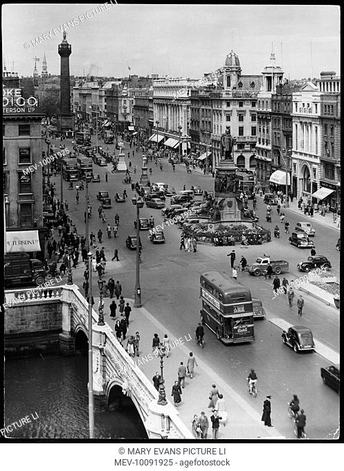 A busy street scene showing O'Connell Bridge and O'Connell Street