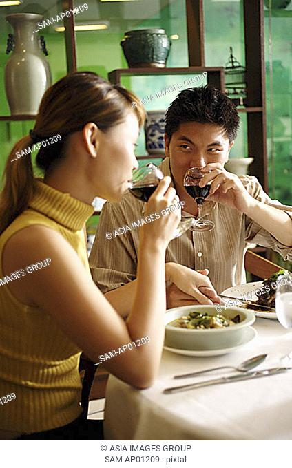 Couple in Chinese restaurant, drinking wine