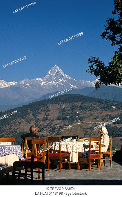 In the Annapurna range,the Machapuchare or Fishtail triangular peak dominates the city of Pokhara and the surrounding valley