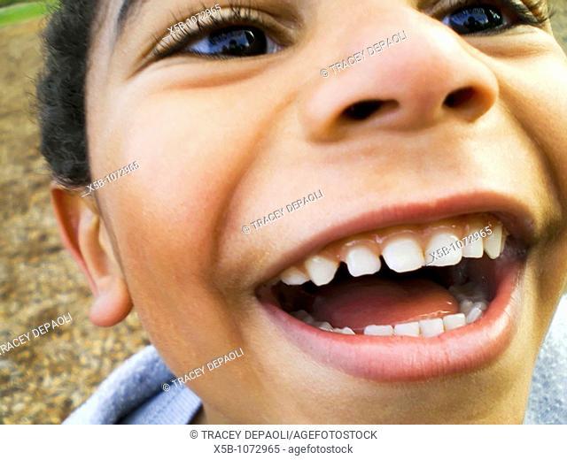 young multiracial boy, laughing joyfully  close up, Horizontal