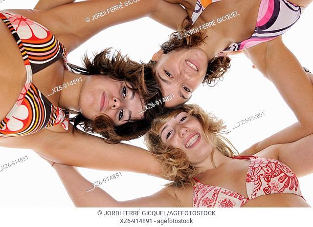 photograph taken from below, girls on the beach