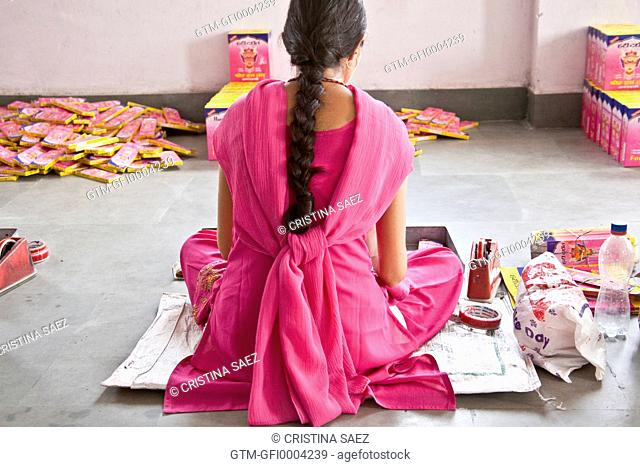 Young Indian Woman in Saree Packing Incense in Factory
