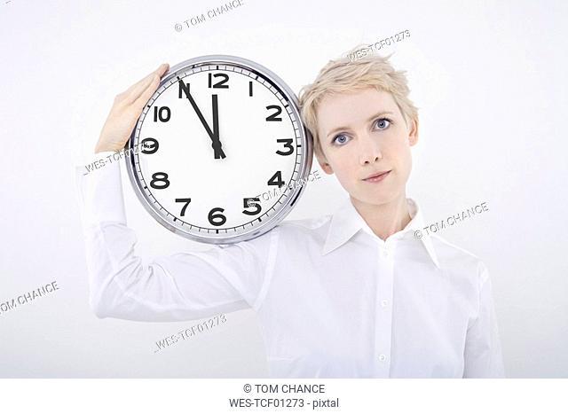 Woman holding clock