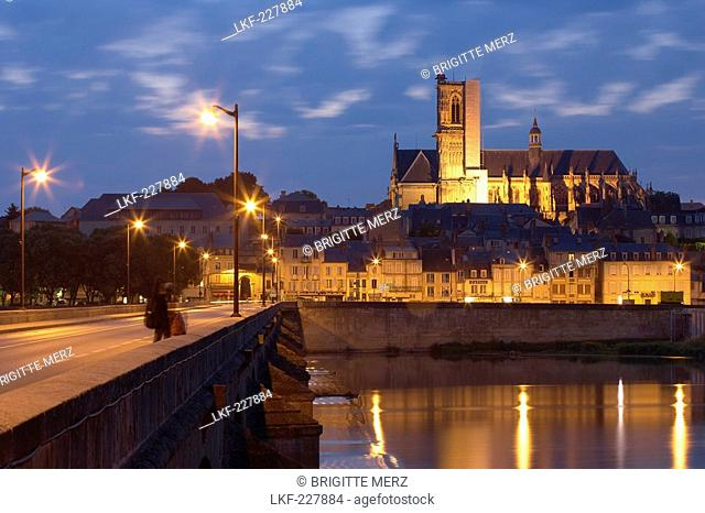 Evening over the old town of Nevers, Saint Cyr et Sainte Julitte Cathedral in the background, Bridge over the river Loire, The Way of St