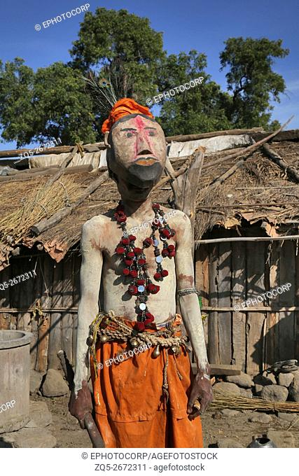 KOLAM TRIBE - Ghusadi man wearing a wooden mask. Shiv Shakti nagar, Gongarwadi, Maharashtra in India