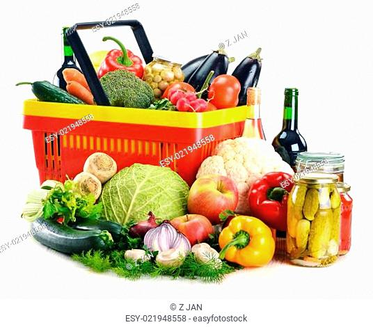 Plastic shopping basket and grocery isolated on white
