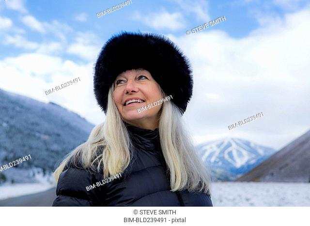 Caucasian woman wearing fur hat in winter