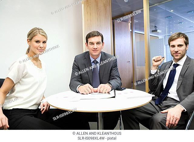 Portrait of businesspeople at table