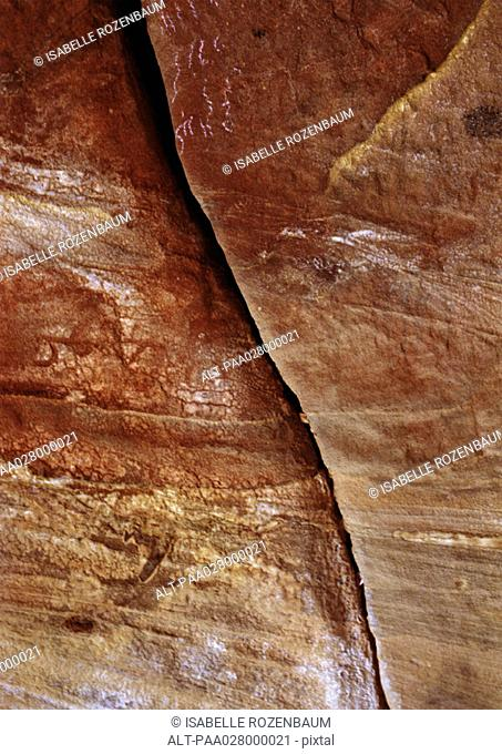 Red rock with crack, close up