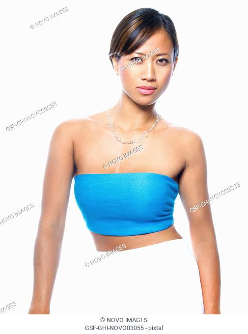 Portrait of Asian Woman in Blue Top and White Pants