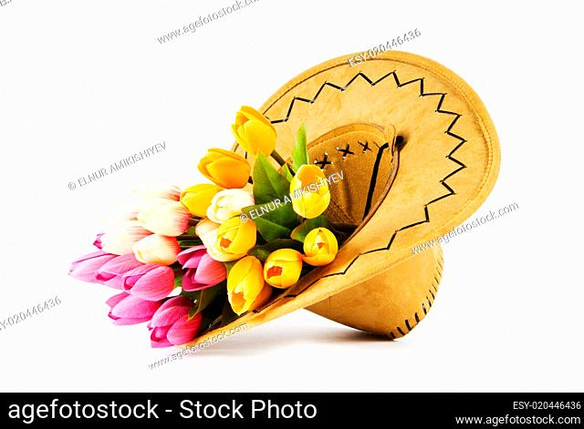 Tulips and cowboy hat isolated on white