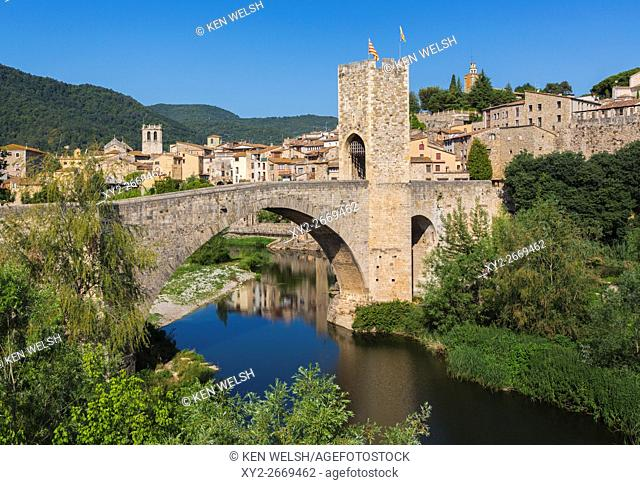 Besalu, Girona Province, Catalonia, Spain. Fortified bridge known as El Pont Vell, the Old Bridge, crossing the Fluvia river