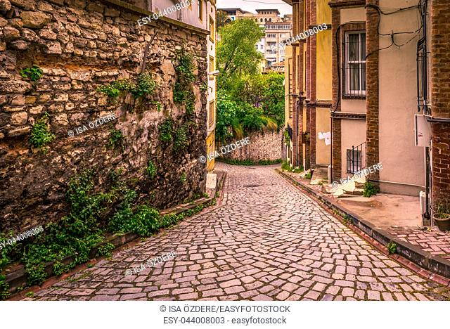 Vintage view of Traditional street and houses at balat area. Street view in historical Balat district. Balat is popular attraction in Istanbul