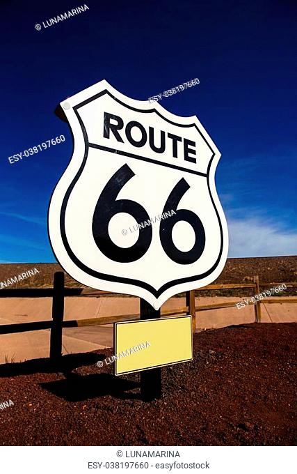 Route 66 road sign in Arizona under blue sky USA