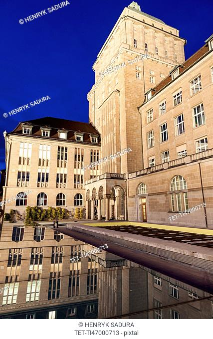 University of Zurich building reflecting in pond