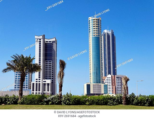 Manama, Bahrain. New hotels and apartments in rapidly developing Seef area. L-R S Hotel, The Breaker, Era Tower and Elite Grande