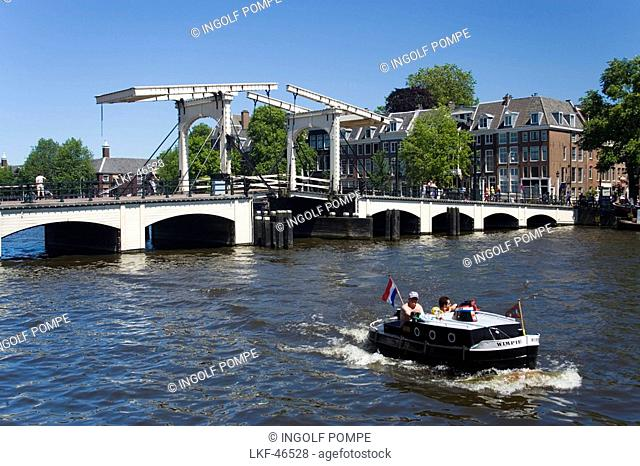 Leisure Boat, Magere Brug, Amstel, View over Amstel with leisure boat to Magere Brug Skinny Bridge, Amsterdam, Holland, Netherlands
