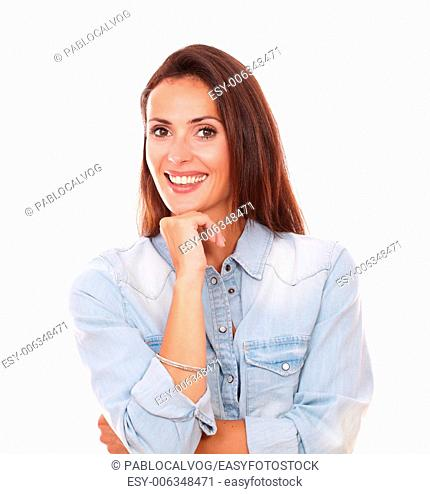 Portrait of satisfied sexy woman on blue shirt smiling at you on isolated studio