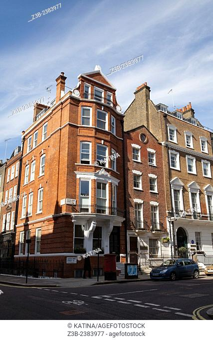 Classic British brick architecture on a bright, sunny day in the Marylebone area of London, England, UK, Europe