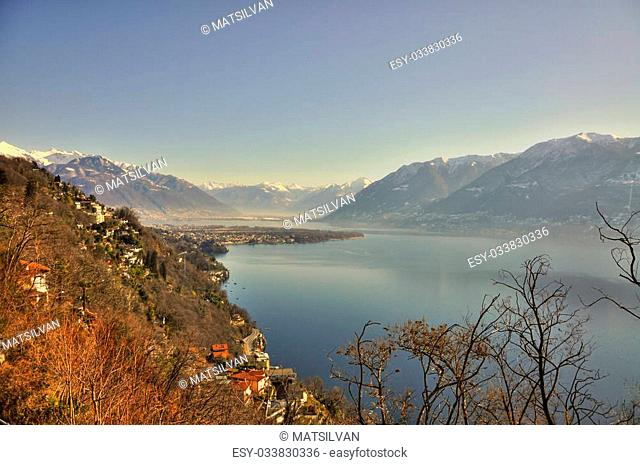 Panoramic view over a lake and snow-capped mountain
