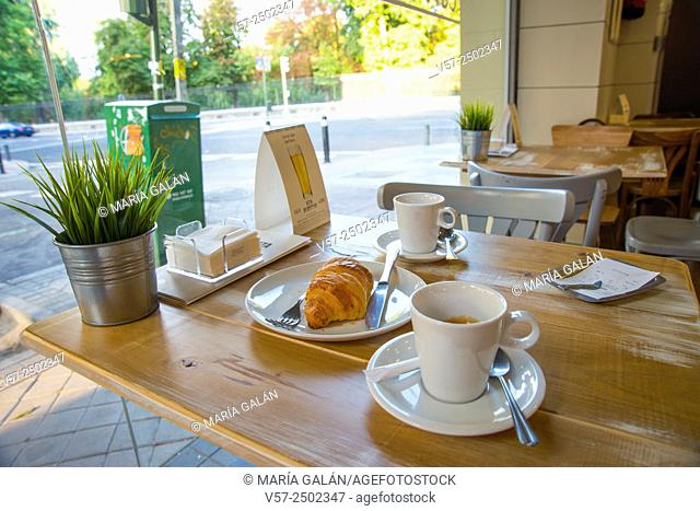 Two cups of coffee and croissant in a cafe. Madrid, Spain