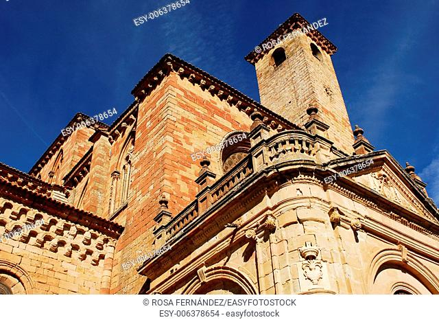 Southern facade of the Cathedral of Sigüenza, initially constructed as a Romanesque church in the twelfth century and finished in Citercian and Gothic styles