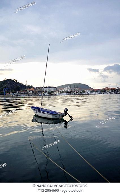 Fishing boat at sunset in Sella River, Ribadesella