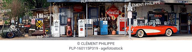 General store along the historic Route 66 with vintage gas pumps, red Corvette and a plethora of classic signs and memorabilia, Hackberry, Arizona