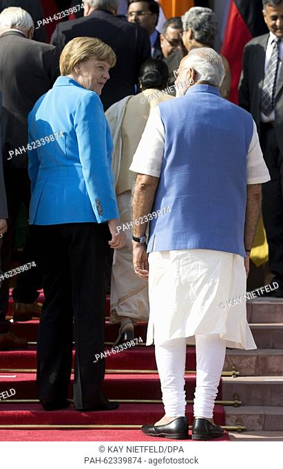 German chancellor Angela Merkel and Indian Prime Minister Narendra Modi speak in front of the Hyderabad House after the third Indian-German intergovernmental...